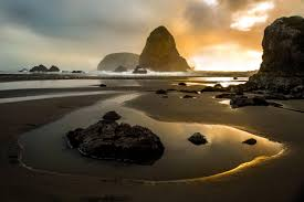 Southern Oregon misty beach at dusk | Walking distance for guests staying at Ocean Suites Motel, Brookings Oregon