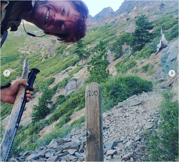 Sean-Nolan-PCT-Lake-Tahoe-and-onto-Sierra-City_Reaching-1200-mile-mark-stake